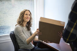 Women happy to receive parcel